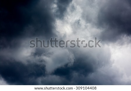 Dark ominous grey storm clouds. Dramatic sky.