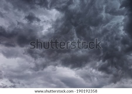 Dark, ominous stormy clouds background - stock photo