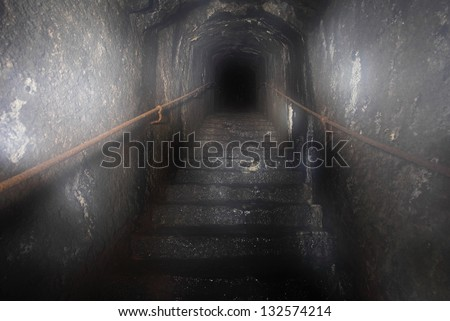 Dark out of the tunnel in the staircase - stock photo
