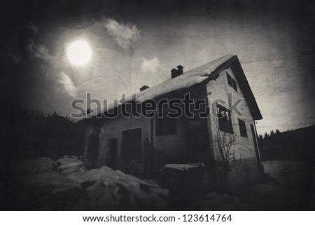 dark over the spooky old house - textured vintage background - stock photo