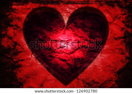 Dark passion: glowing red heart black. Rough vibrant red texture with burnt edges. - stock photo