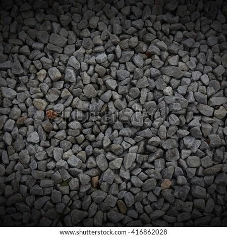 dark pebble stones. - stock photo