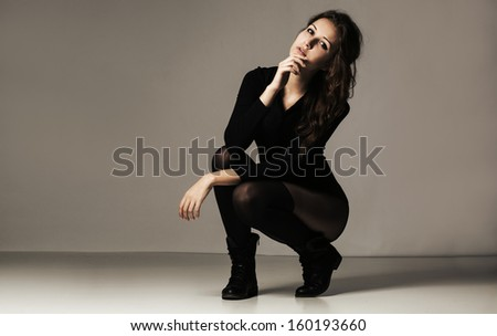 Dark photo of a sexy woman - stock photo