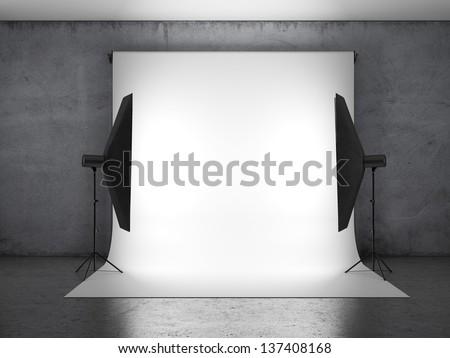 Dark photo studio with lighting equipment - stock photo