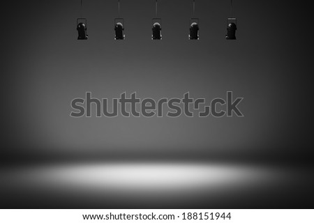 Dark photo studio with spotlights - stock photo