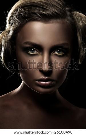 Dark portrait of a beautiful girl, studio shot - stock photo