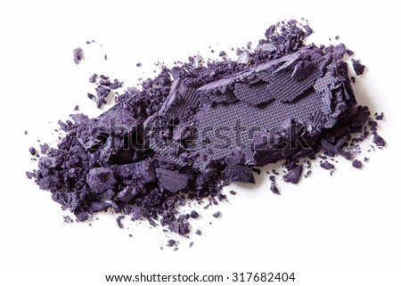 Dark purple eye shadow crushed make up on white background - stock photo
