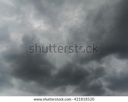 Dark rain clouds  in a windy day. - stock photo