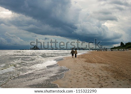 Dark Rain Clouds over Baltic Sea Beach of Heringsdorf, Usedom Islan, Germany - stock photo