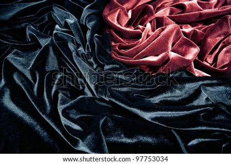dark red and black glossy velvet is formative folds and light-shadow picture - stock photo
