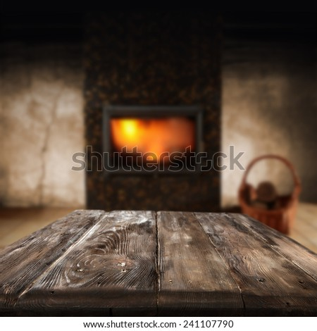 dark retro interior with fireplace and table in home