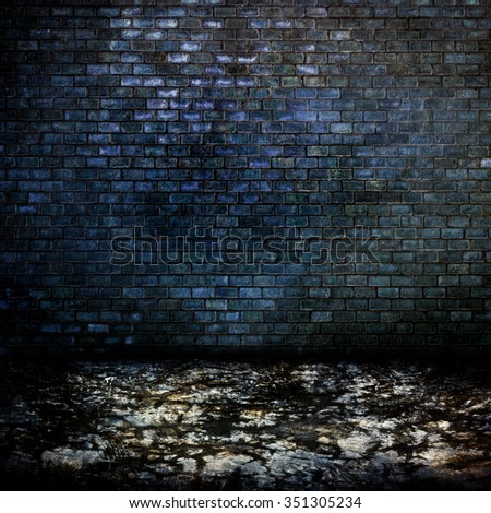 Dark room with cement floor and brick wall background - stock photo