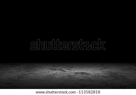 Dark room with grunge floor background - stock photo