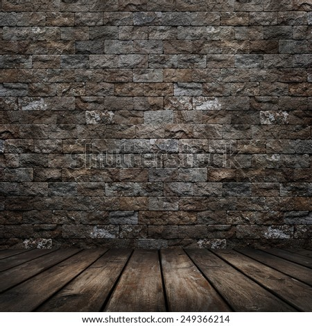 Dark room with wood floor and brick wall background - stock photo