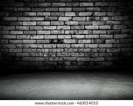Dark room with wooden floor and brick wall background. - stock photo