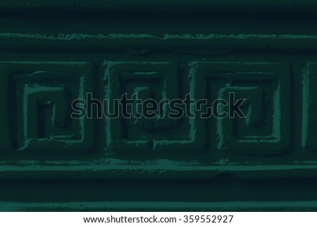 Dark sea Background with a bas-relief of plaster in the style of ancient Greek patterns.