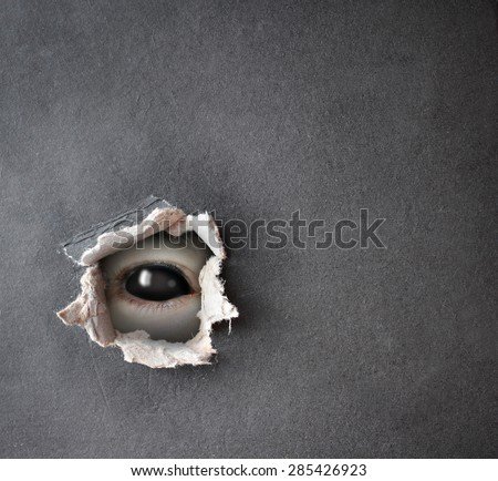 Dark series - a look from darkness. Monster eye in hole in the paper