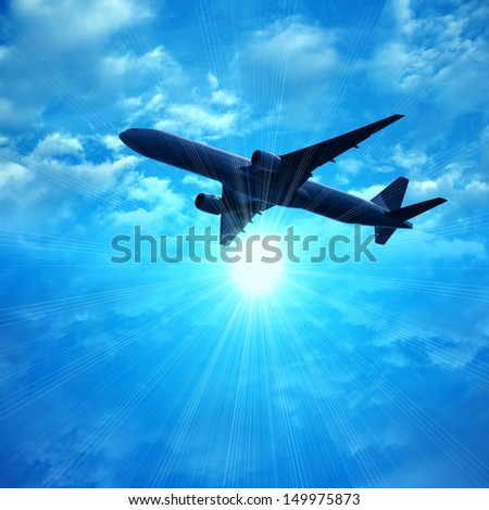 dark silhouette of airplane flying over blue sky with sun and clouds background