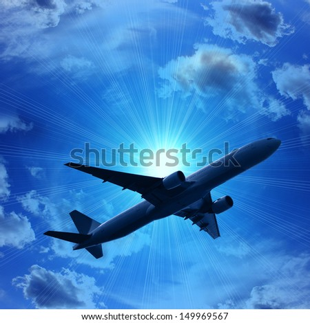 dark silhouette of airplane flying over blue sky with sun and clouds in the evening background