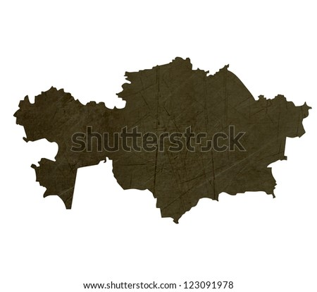 Dark silhouetted and textured map of Kazahkstan isolated on white background.