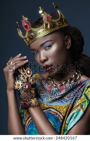 dark-skinned girl in a massive jewelry with exotic makeup