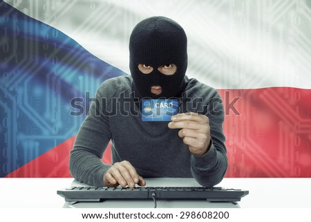 Dark-skinned hacker with credit card and flag on background - Czech Republic - stock photo