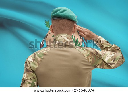 Dark-skinned soldier in hat facing US state flag series - Oklahoma - stock photo