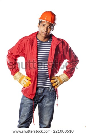 dark-skinned worker with helmet and gloves, to show compassion - stock photo