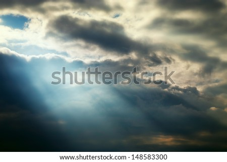 dark sky stormy clouds and blue lighting effects - stock photo