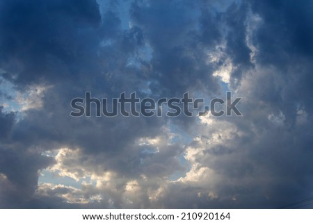 Dark sky with clouds before thunderstorm, moody scene - stock photo