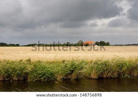 dark sky with farmland - stock photo