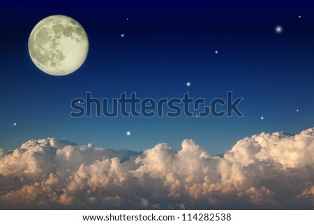dark sky with large clouds and full moon - stock photo