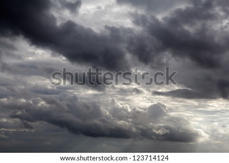 Dark sky with storm clouds - stock photo