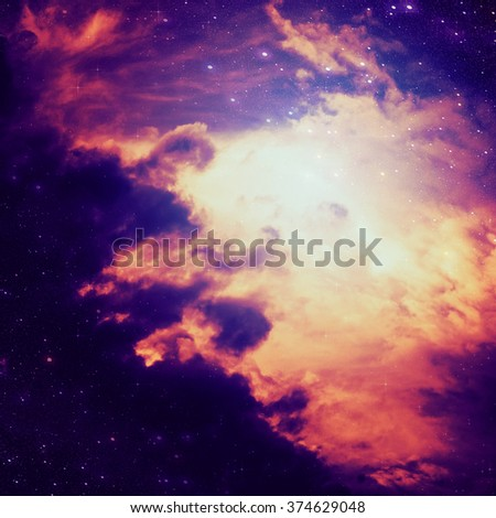Dark space background with clouds and stars.