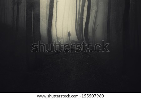 dark spooky forest with man scratched photograph - stock photo