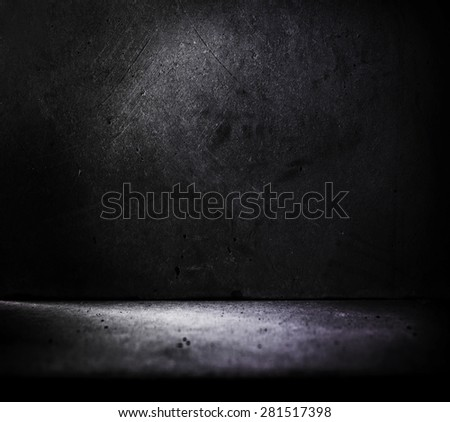 Dark stone or concrete room with incoming light. - stock photo