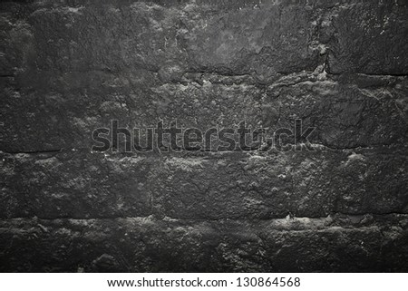 Dark stone wall texture background - stock photo