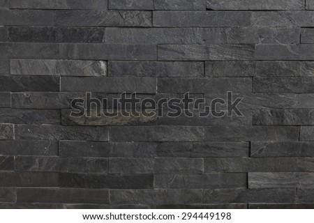 Dark Stone wall Texture background. - stock photo