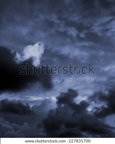Dark storm clouds before rain. - stock photo