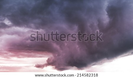 dark storm clouds before rain at sunset. - stock photo