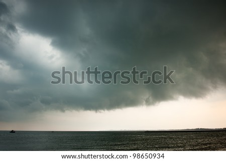 Dark storm clouds forming before the rain - stock photo