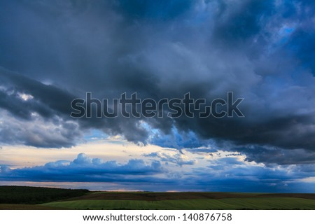 Dark storm clouds on evening sky
