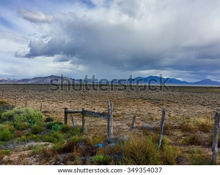 Dark Storm in the Nevada Desert with Old Fence