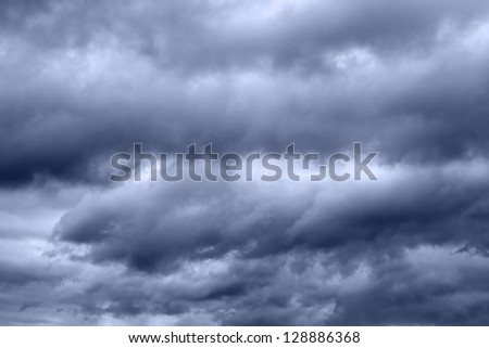 Dark stormy clouds in the sky - stock photo