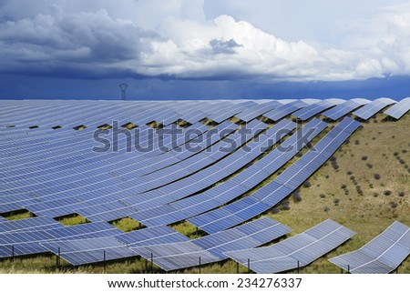 Dark stormy sky above a solar power plant in France