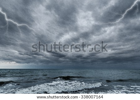 Dark stormy sky above the ocean surface.