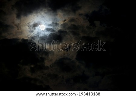 Dark stormy sky with moon - stock photo