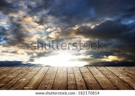 dark stormy sky with sunset background - stock photo