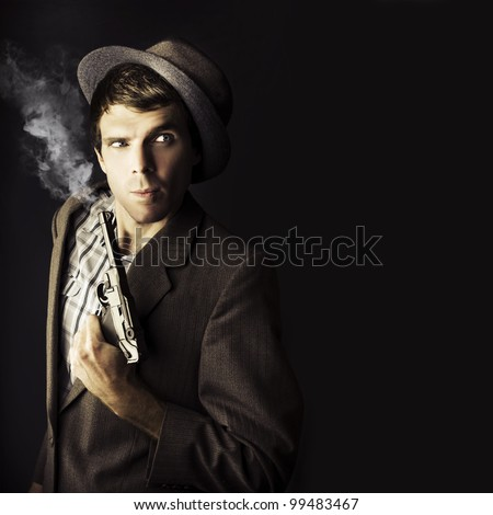 Dark Studio Image Of A Professional Hit Man Wearing Vintage Suit Holding A Retro Hand Gun In A Dangerous Business Conceptual, Isolated On Black Background