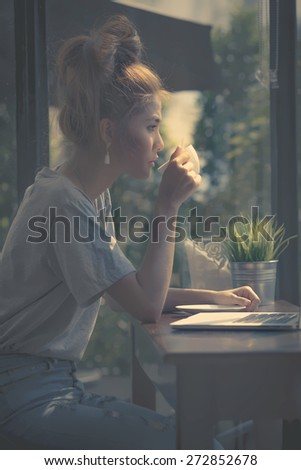 Dark style beauty some only position of the light down adult woman sipping coffee looking through window and thinking for plan something vintage morning she as always thinking sitting at cafe coffee - stock photo